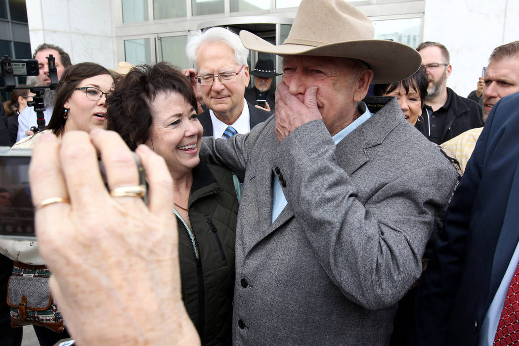 Cliven Bundy hugs his wife, Carol talk to the news media after walking out of Lloyd George U.S. Courthouse in Las Vegas a free man Monday, Jan. 8, 2017, after a federal judge dismissed the case wi ...