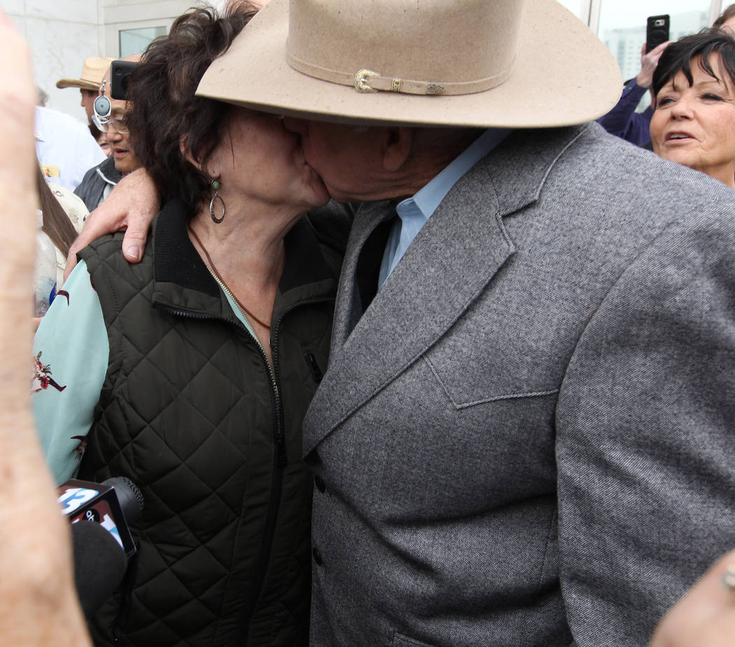Cliven Bundy kisses his wife, Carol after walking out of Lloyd George U.S. Courthouse in Las Vegas a free man Monday, Jan. 8, 2017, after a federal judge dismissed the case with prejudice against  ...