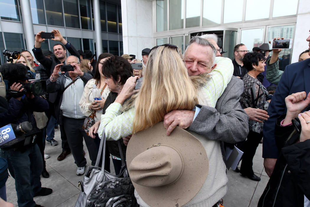 Cliven Bundy hugs a supporter after walking out of Lloyd George U.S. Courthouse in Las Vegas a free man Monday, Jan. 8, 2017, after a federal judge dismissed the case with prejudice against him, t ...