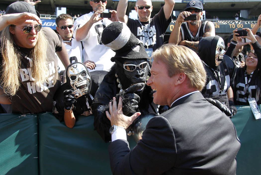 NFL broadcaster and former Oakland Raiders head coach Jon Gruden greets fans before an NFL preseason football game between the Oakland Raiders and the Dallas Cowboys in Oakland, Calif., Monday, Au ...
