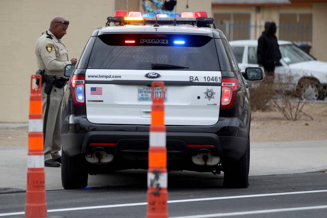 Las Vegas police investigate on H street at West McWilliams Avenue near Bonanza Road, Monday, Jan. 8, 2018. A man taken to University Medical Center after a stabbing in the 400 block of West Bonan ...