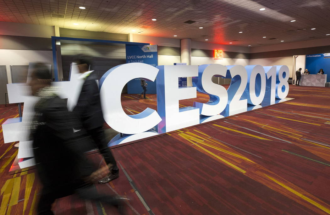 People walk past a #CES2018 sign at the Las Vegas Convention Center during setup for CES on Monday, Jan. 8, 2018, in Las Vegas. Richard Brian Las Vegas Review-Journal @vegasphotograph