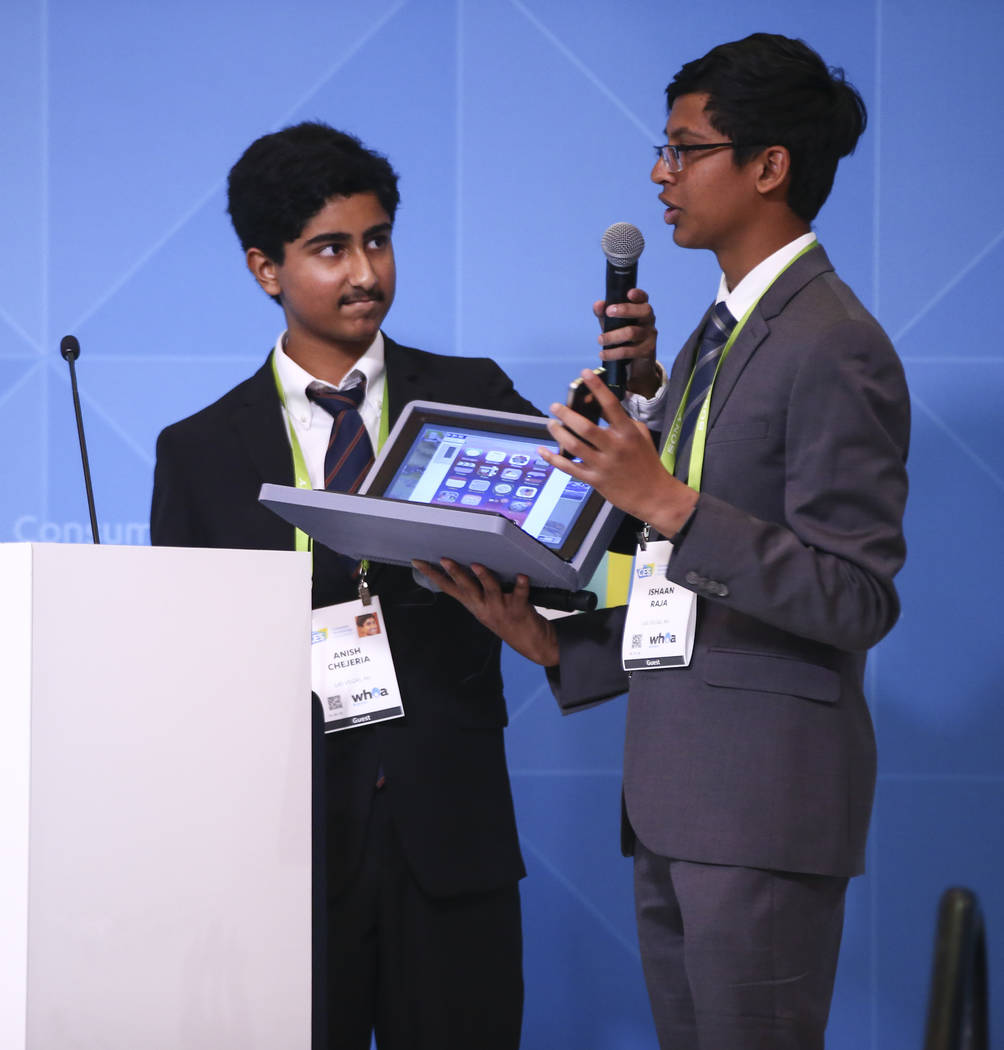 Southwest Career and Technical Academy students Anish Chejerla, left, and Ishaan Raja present their pitch during the student business pitch competition at the Consumer Technology Association stage ...