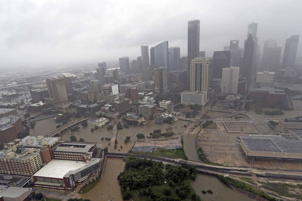 Highways around downtown Houston are empty as floodwaters from Tropical Storm Harvey overflow from the bayous around the city in Houston, Aug. 29, 2017. (David J. Phillip/AP Photo, File)