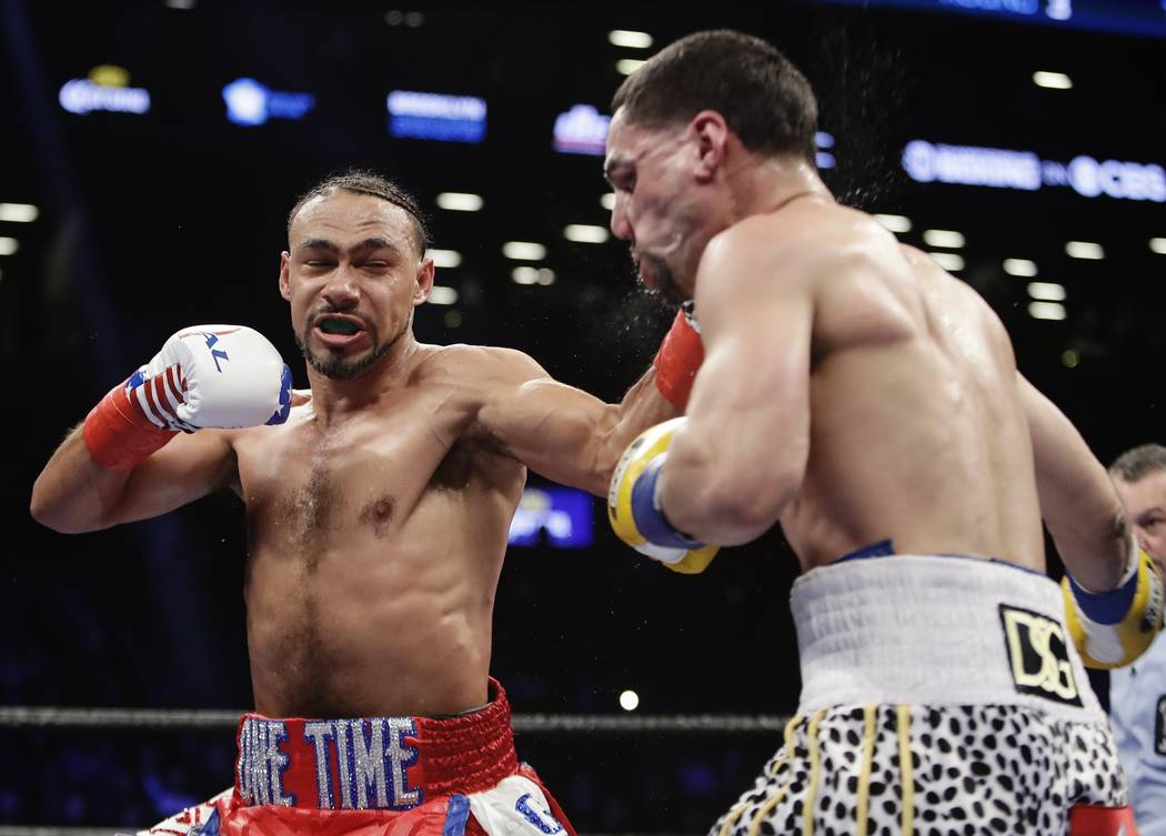 Keith Thurman punches Danny Garcia, right, during the third round of a welterweight championship boxing match Saturday, March 4, 2017, in New York. Thurman won the fight. (AP Photo/Frank Franklin II)