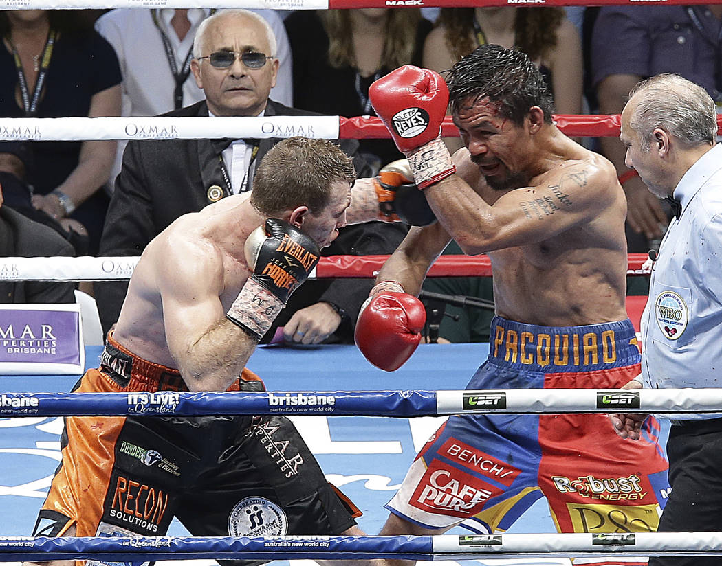 Manny Pacquiao of the Philippines, left, and Jeff Horn of Australia fight during their WBO World welterweight title bout in Brisbane, Australia, Sunday, July 2, 2017. Pacquiao lost his WBO welterw ...