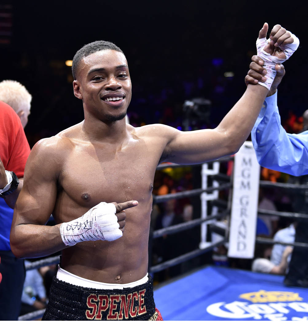 Errol Spence Jr., celebrates his welterweight win after defeating Phil Lo Greco, from Canada, in the third round of a welterweight fight on Saturday, June 20, 2015, in Las Vegas. (AP Photo/David B ...
