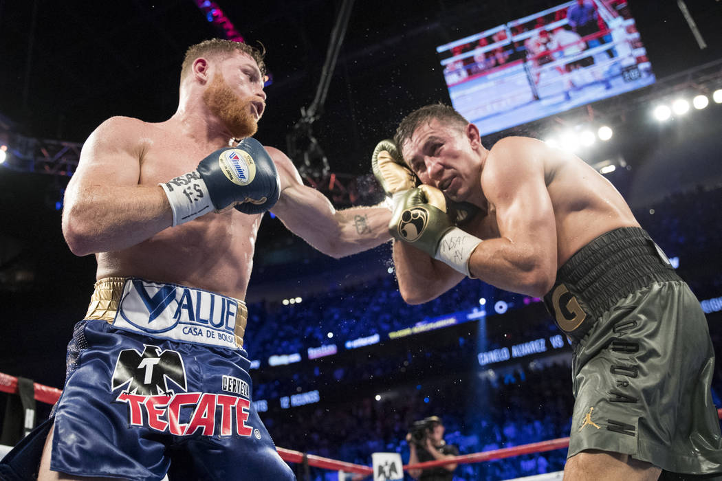 Saul Canelo Alvarez, left, throws a punch against Gennady GGG Golovkin in the WBC, WBA, IBF, RING middleweight title bout at T-Mobile Arena in Las Vegas, Saturday, Sept. 16, 2017. The fight ended  ...