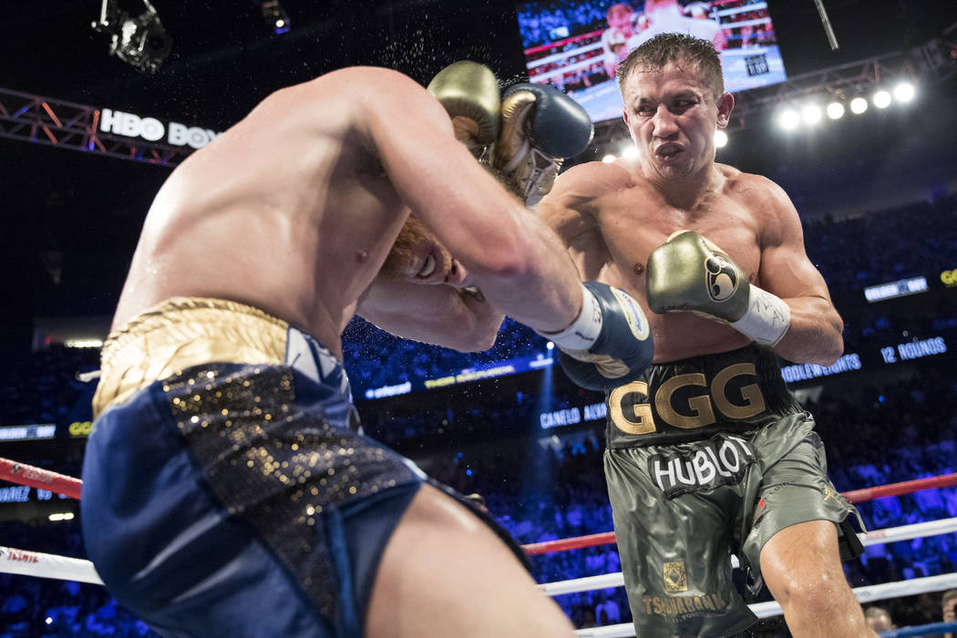 Gennady Golovkin, right, throws a punch against Saul Alvarez in the WBC, WBA, IBF, RING middleweight title bout at T-Mobile Arena in Las Vegas, Saturday, Sept. 16, 2017. The fight ended in a split ...