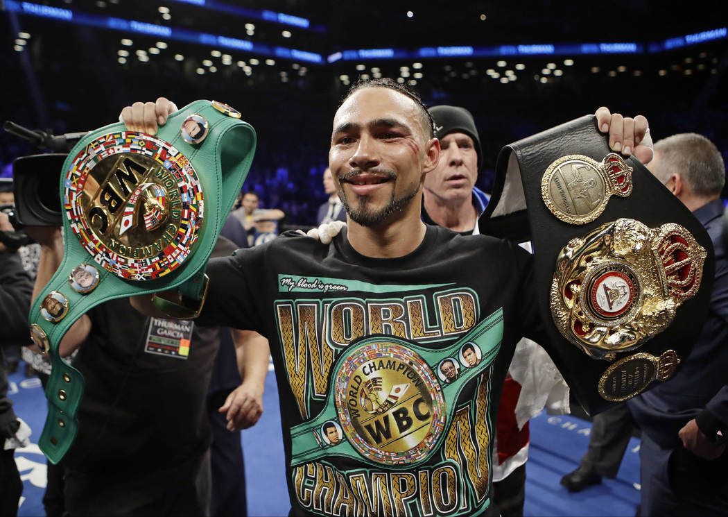 Keith Thurman poses for photographs after a welterweight championship boxing match against Danny Garcia on Saturday, March 4, 2017, in New York. Thurman won the fight. (AP Photo/Frank Franklin II)