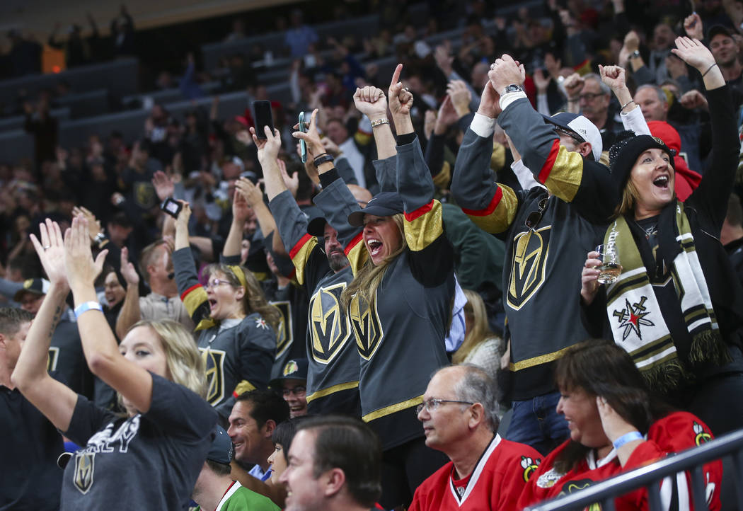 Golden Knights fans celebrate the first goal against the Chicago Blackhawks during an NHL hockey game at T-Mobile Arena in Las Vegas on Tuesday, Oct. 24, 2017. (Chase Stevens/Las Vegas Review-Jour ...