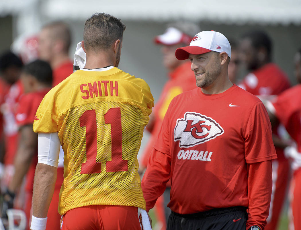 Kansas City Chiefs quarterback Alex Smith talks with quarterbacks coach Matt Nagy at NFL football training camp in St. Joseph, Mo., Aug. 5, 2015. Chicago Bears general manager Ryan Pace announced  ...
