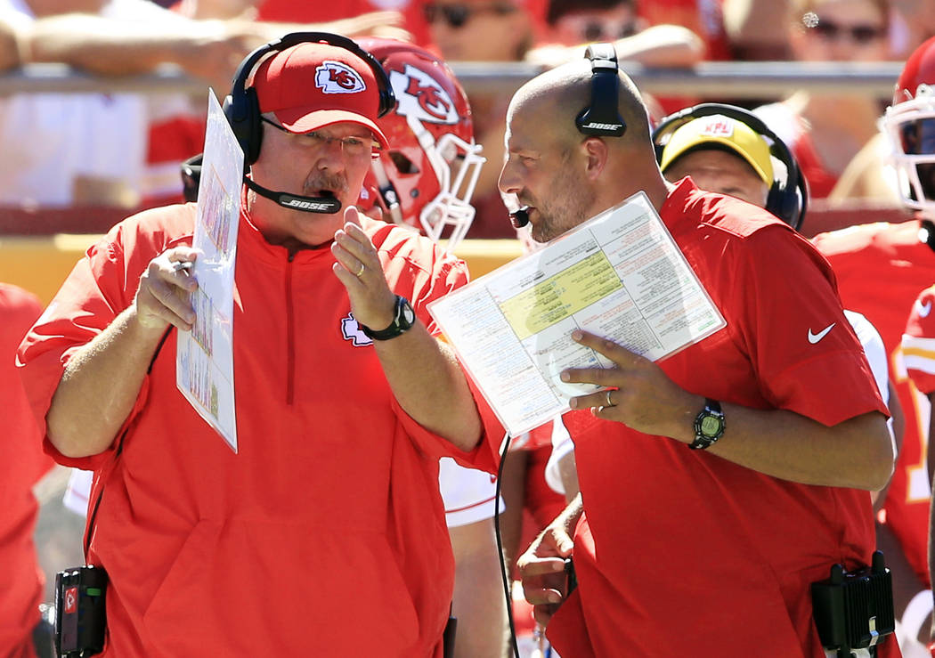Kansas City Chiefs head coach Andy Reid, left, and co-offensive coordinator Matt Nagy talk during the first half of an NFL preseason football game against the Seattle Seahawks in Kansas City, Mo., ...