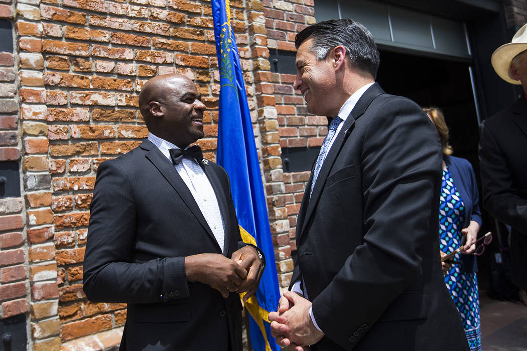 Sen. Kelvin Atkinson, D-North Las Vegas, left, talks with Gov. Brian Sandoval at The Union restaurant and brewery in Carson City on Monday, June 5, 2017. Chase Stevens Las Vegas Review-Journal @cs ...