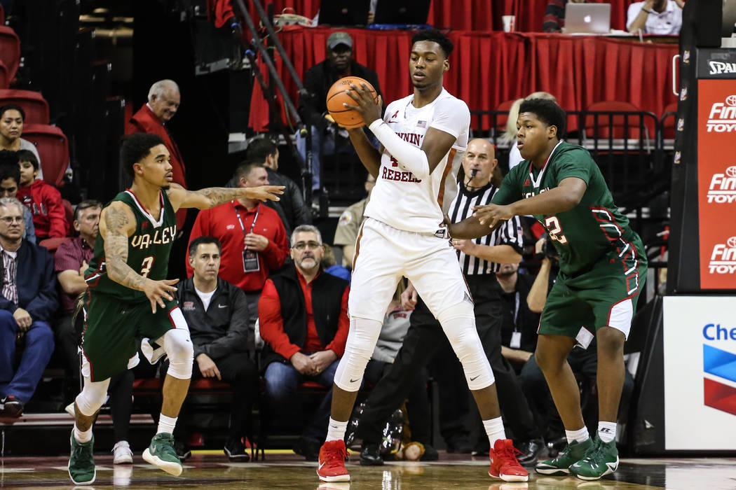 UNLV Rebels forward Brandon McCoy (44) is guarded by Mississippi Valley State Delta Devils guard Jordan Evans (3) and Mississippi Valley State Delta Devils center Kaleb Allison (32) during the fir ...
