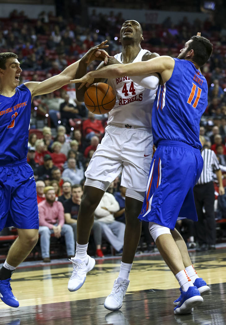 UNLV Rebels forward Brandon McCoy (44) is blocked by Boise State Broncos forward Zach Haney (11) during the first period of an NCAA college basketball game at the Thomas & Mack Center Saturday ...