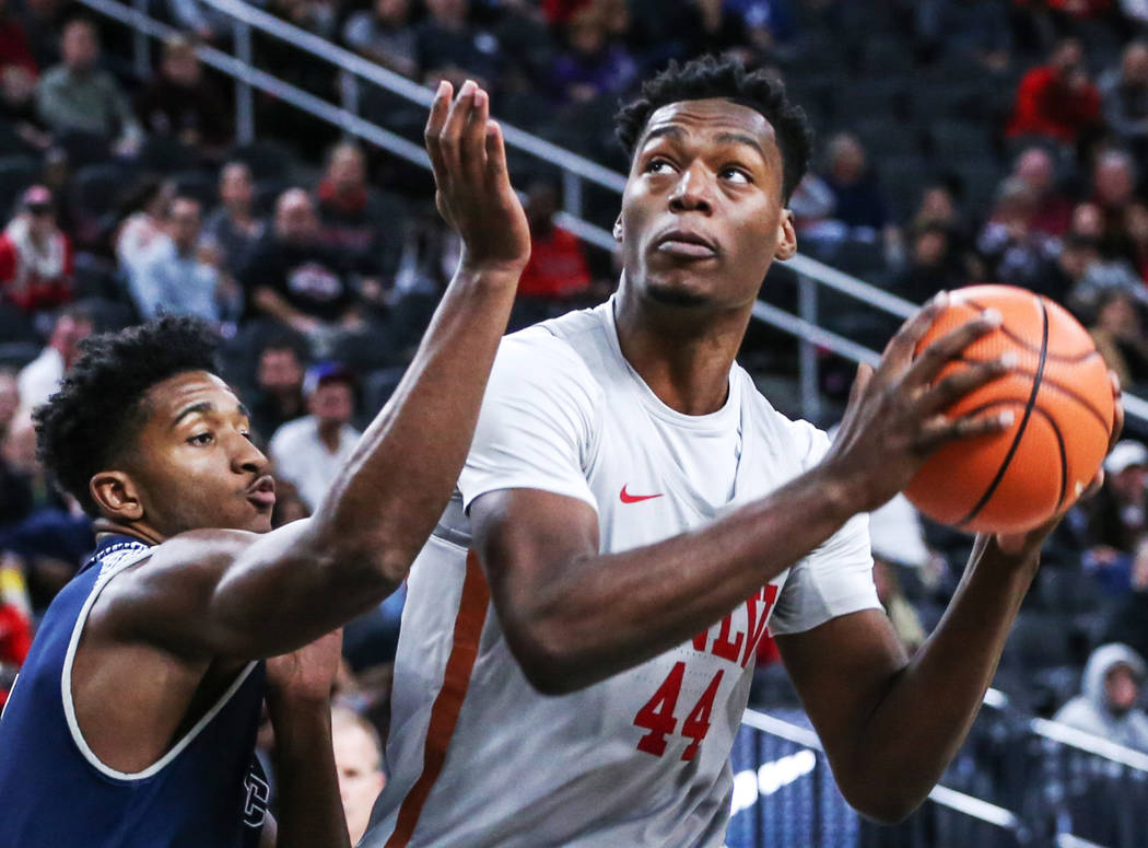 UNLV Rebels forward Brandon McCoy (44), right, is blocked by the Rice Owls during the first half of basketball game during day one of the MGM Grand Main Event tournament at T-Mobile Arena in Las V ...