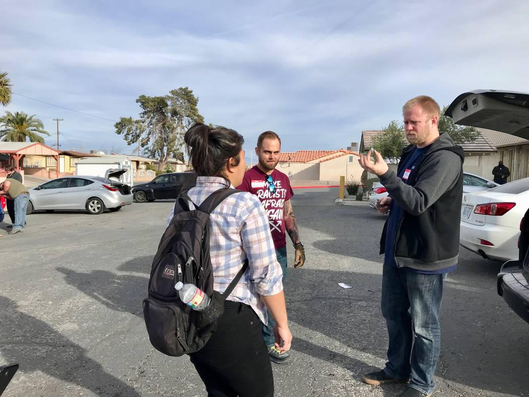 DSA members discuss what type of bulb is needed for a brake light change at the at the Democratic Socialists of America Las Vegas chapter's first brake light change event at First African Methodis ...