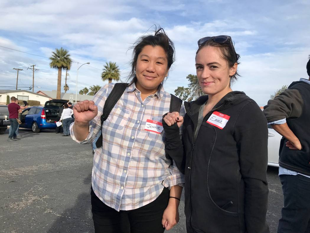 Jennie Yim (left) and Emma Coombes (right) stand together at the Democratic Socialists of America Las Vegas chapter's first brake light change event at First African Methodist Episcopal Church in  ...