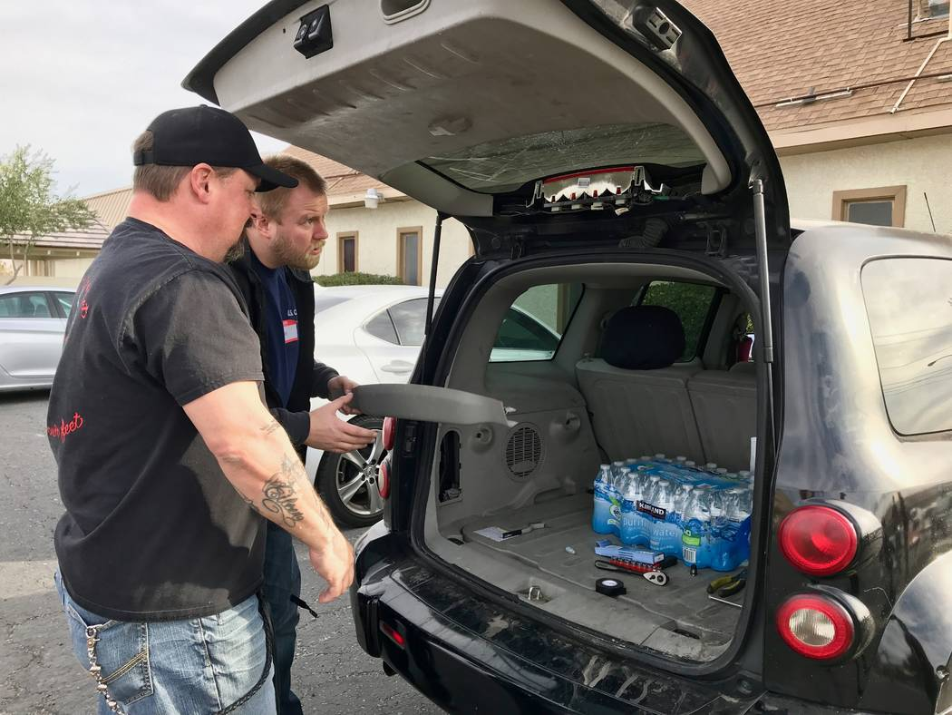 Volunteers change a vehicle brake light at the Democratic Socialists of America Las Vegas chapter's first brake light change event at First African Methodist Episcopal Church in North Las Vegas, J ...