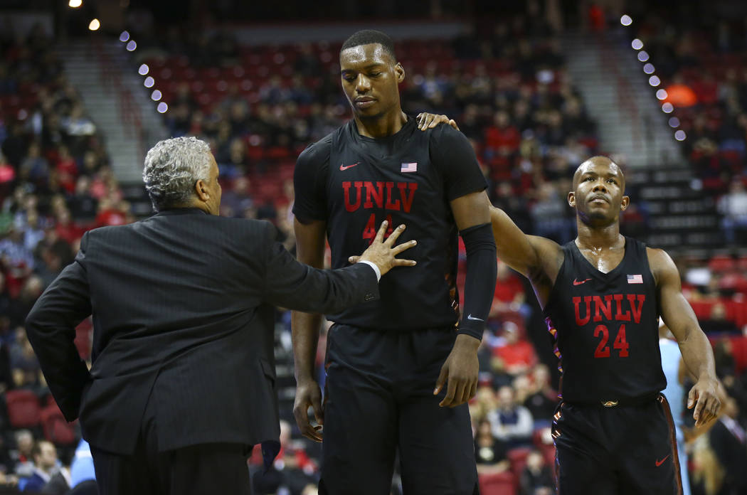 UNLV Rebels guard Jordan Johnson (24) comforts UNLV Rebels forward Brandon McCoy (44) as he returns to the bench after drawing a technical foul during a basketball game at Thomas & Mack Center ...