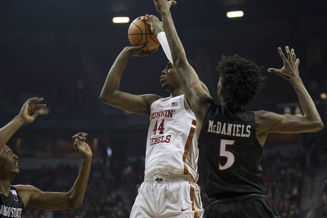 UNLV Rebels forward Brandon McCoy (44) goes up for a shot against San Diego State Aztecs forward Malik Pope (21) and forward Jalen McDaniels (5) at the Thomas & Mack Center in Las Vegas, Satur ...