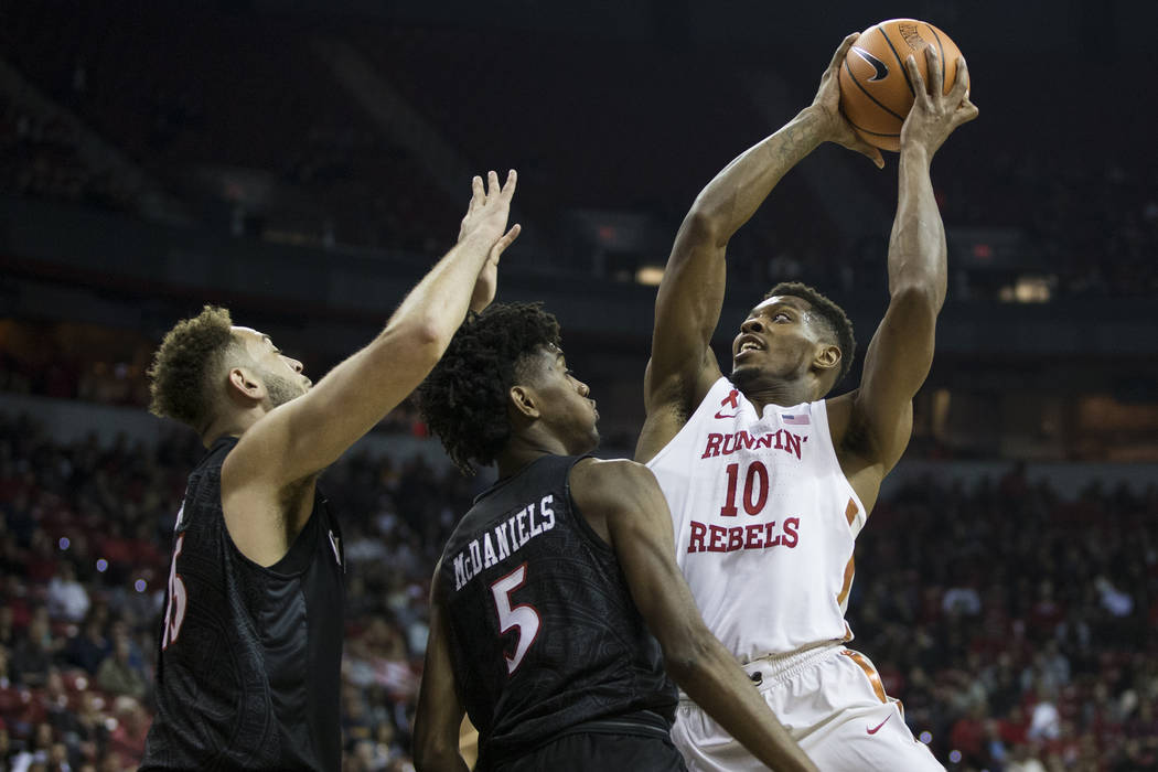 UNLV Rebels forward Shakur Juiston (10) goes up for a shot against San Diego State Aztecs forward Jalen McDaniels (5) and center Kameron Rooks (45) at the Thomas & Mack Center in Las Vegas, Sa ...