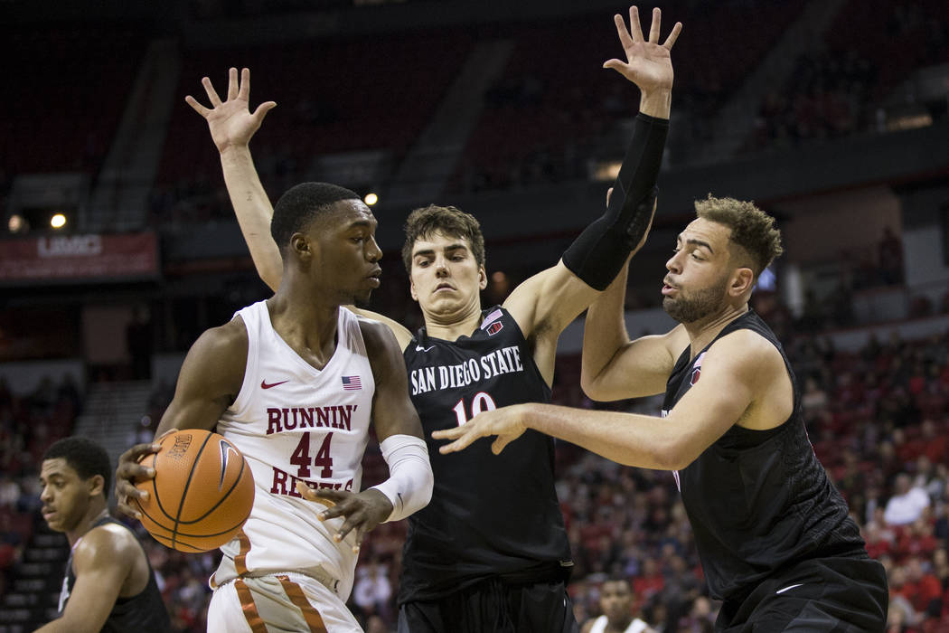 UNLV Rebels forward Brandon McCoy (44) is pressured by San Diego State Aztecs forward Max Montana (10) and center Kameron Rooks (45) at the Thomas & Mack Center in Las Vegas, Saturday, Jan. 27 ...