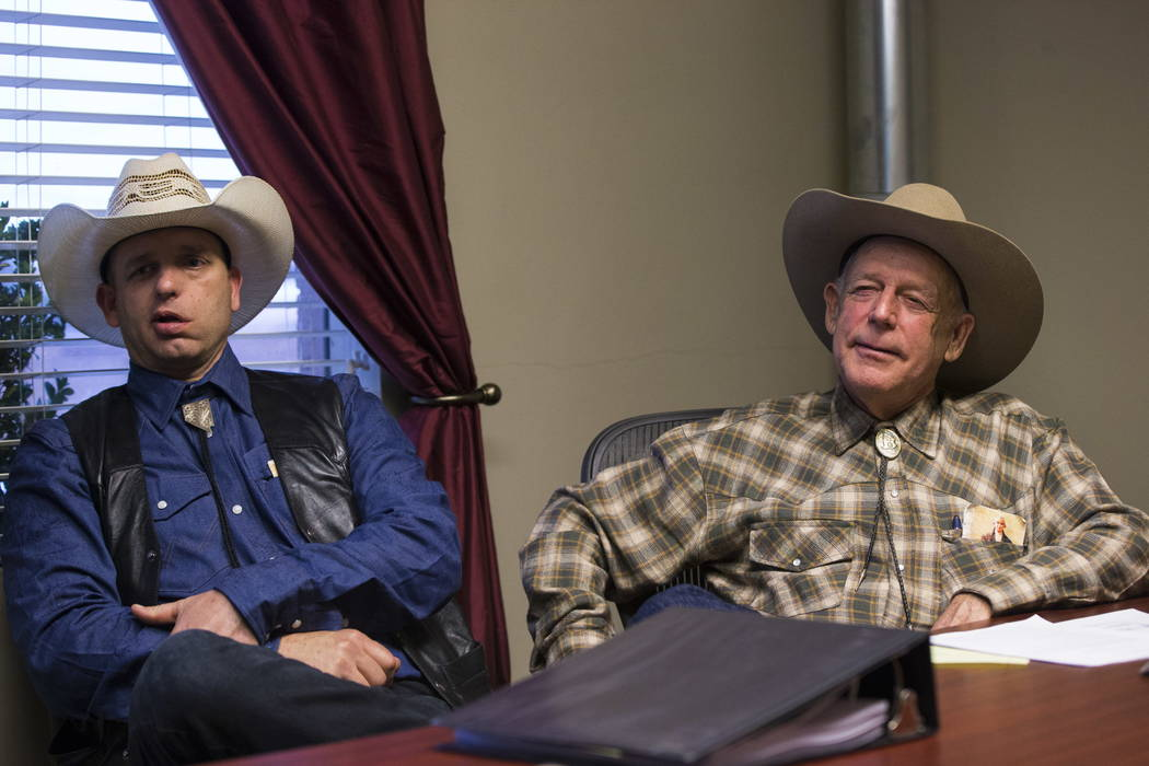 Ryan Bundy, left, and his father, Bunkerville rancher Cliven Bundy, at the office of defense attorney Bret Whipple in downtown Las Vegas on Tuesday, Jan. 9, 2018. Federal charges against Ryan and  ...