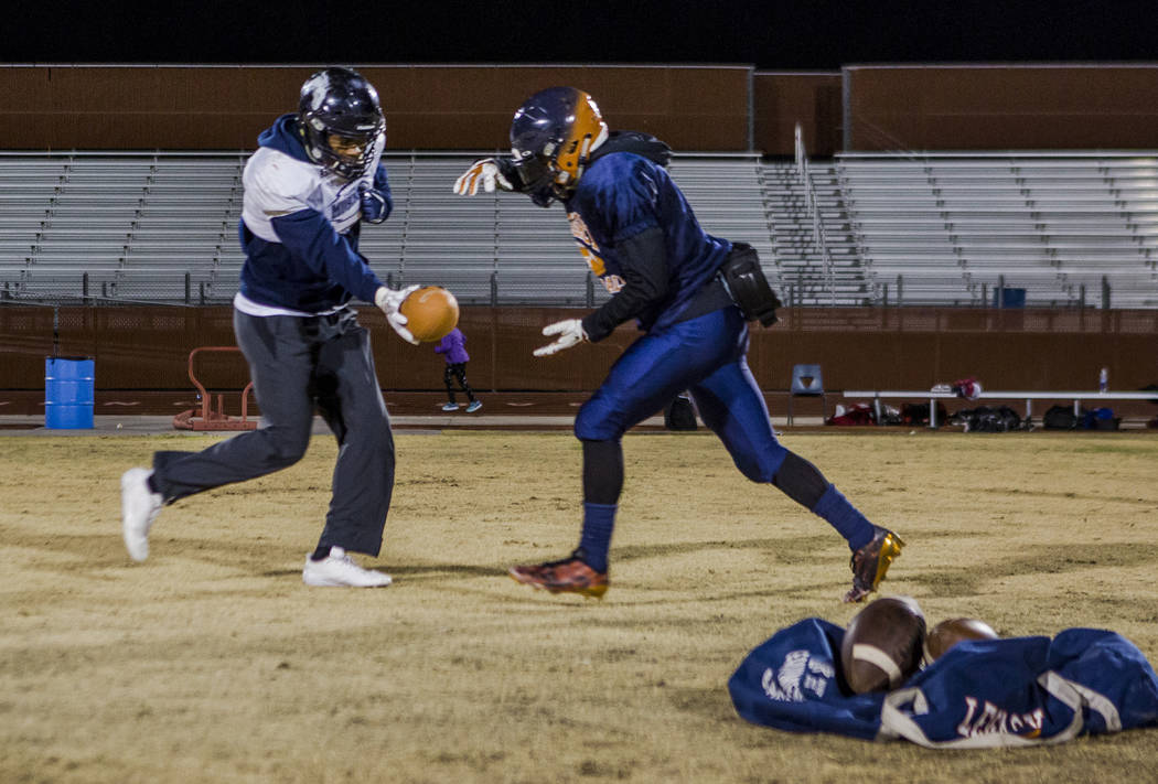 Legacy running back Aubrey Washington, right, practices for the all-star game at Legacy High School on Wednesday, Jan. 10, 2018. Patrick Connolly Las Vegas Review-Journal @PConnPie