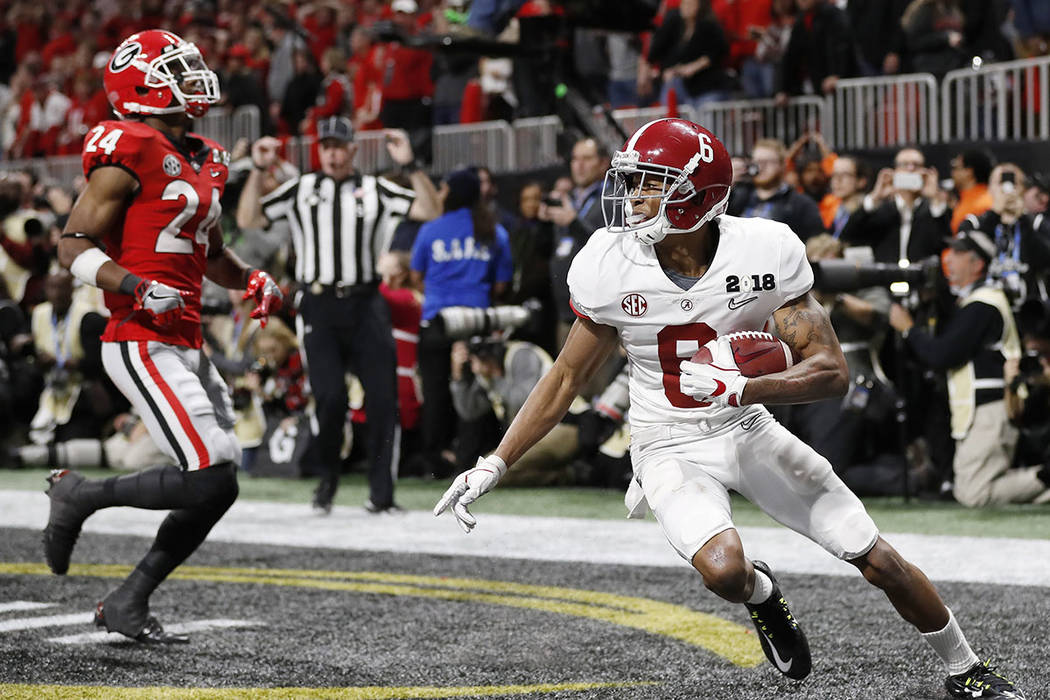 Alabama wide receiver DeVonta Smith (6) makes a touchdown catch against Georgia during overtime of the NCAA college football playoff championship game Monday, Jan. 8, 2018, in Atlanta. Alabama won ...