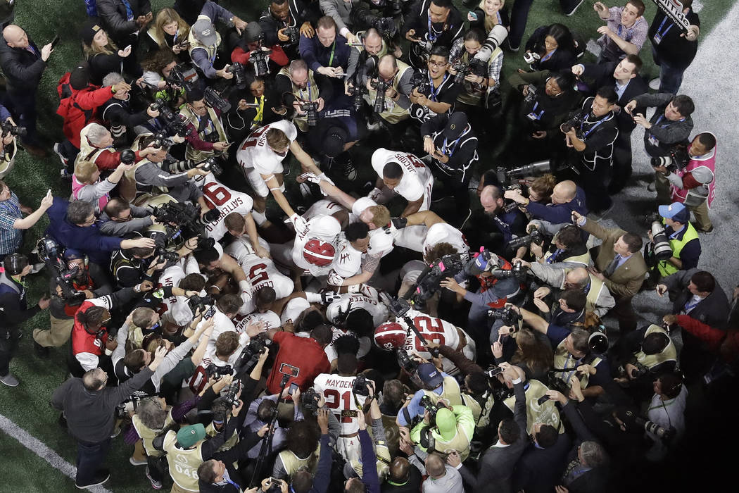 Alabama players celebrate after overtime of the NCAA college football playoff championship game against Georgia Monday, Jan. 8, 2018, in Atlanta. Alabama won 26-23. (AP Photo/John Bazemore)