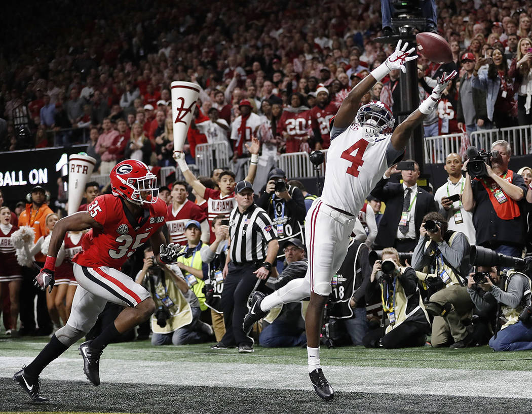 Alabama's Jerry Jeudy can't catch a pass in the end zone during the second half of the NCAA college football playoff championship game against Georgia Monday, Jan. 8, 2018, in Atlanta. (AP Photo/D ...