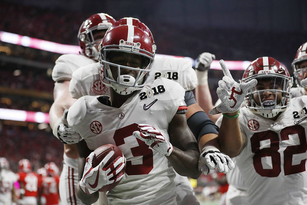 Alabama's Calvin Ridley celebrates his touchdown catch during the second half of the NCAA college football playoff championship game against Georgia Monday, Jan. 8, 2018, in Atlanta. (AP Photo/Dav ...