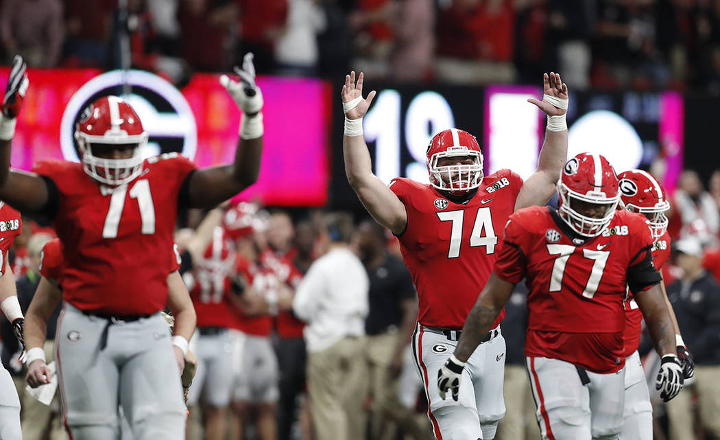 Georgia react after a replay confirmed a touchdown during the second half of the NCAA college football playoff championship game against Alabama Monday, Jan. 8, 2018, in Atlanta. (AP Photo/David G ...