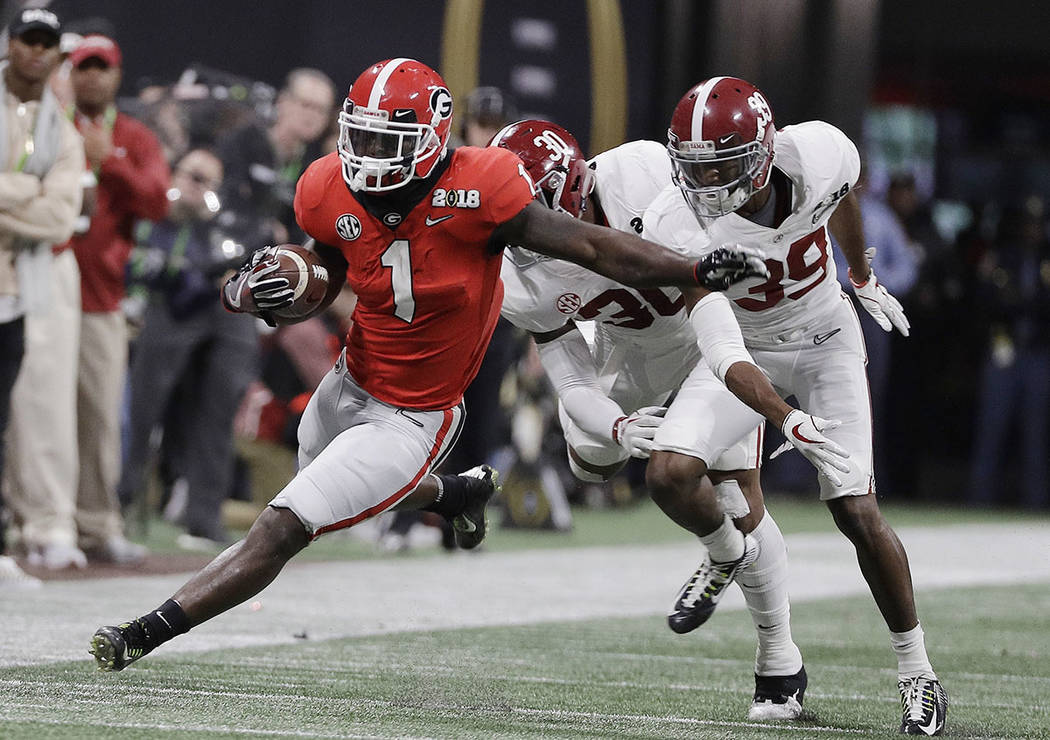 Georgia running back Sony Michel runs doer a first down during the first half of the NCAA college football playoff championship game against Alabama Monday, Jan. 8, 2018, in Atlanta. (AP Photo/Dav ...