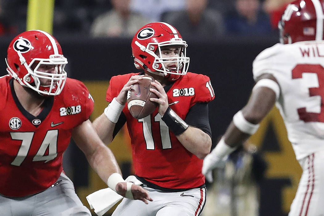 Georgia quarterback Jake Fromm throws during the first half of the NCAA college football playoff championship game against Alabama Monday, Jan. 8, 2018, in Atlanta. (AP Photo/David Goldman)
