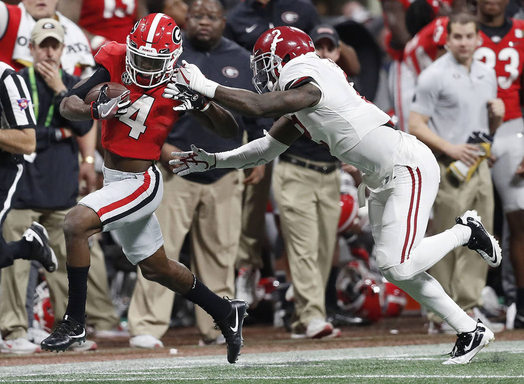 Georgia wide receiver Mecole Hardman gets past Alabama defensive back Tony Brown for a touchdown catch during the second half of the NCAA college football playoff championship game Monday, Jan. 8, ...