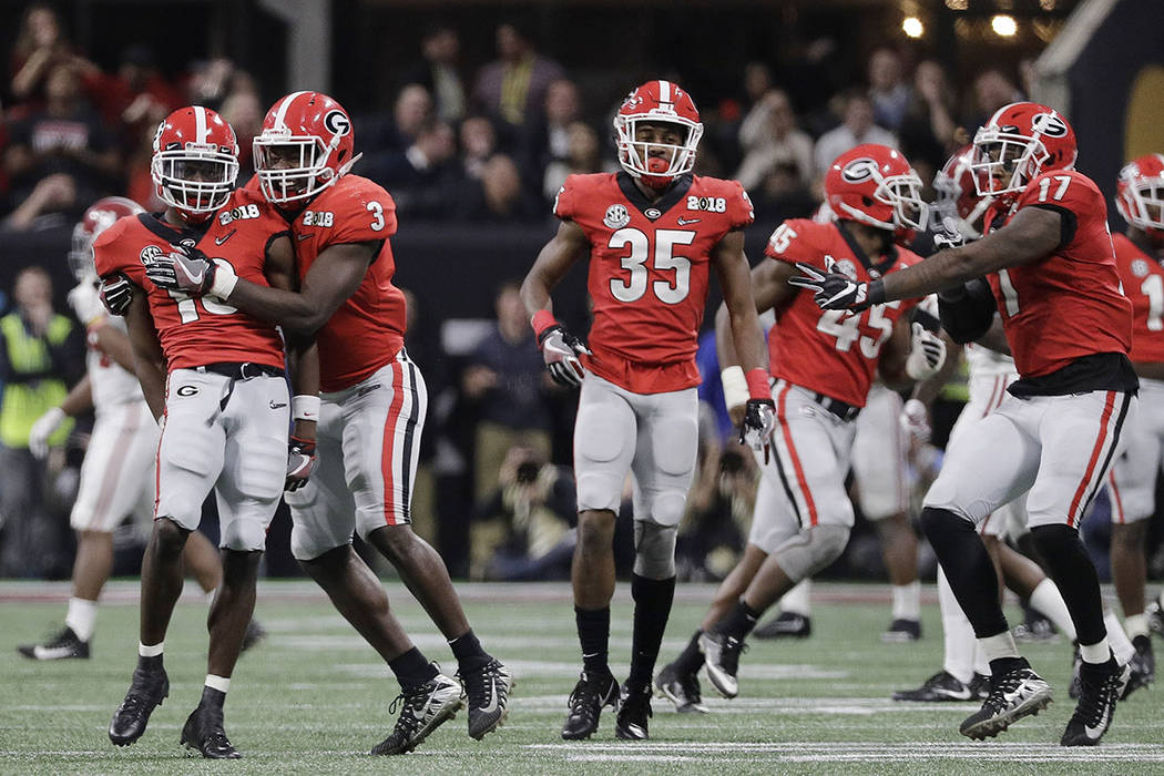 Georgia's Deandre Baker is congratulated after intercepting a pass during the second half of the NCAA college football playoff championship game against Alabama Monday, Jan. 8, 2018, in Atlanta. ( ...