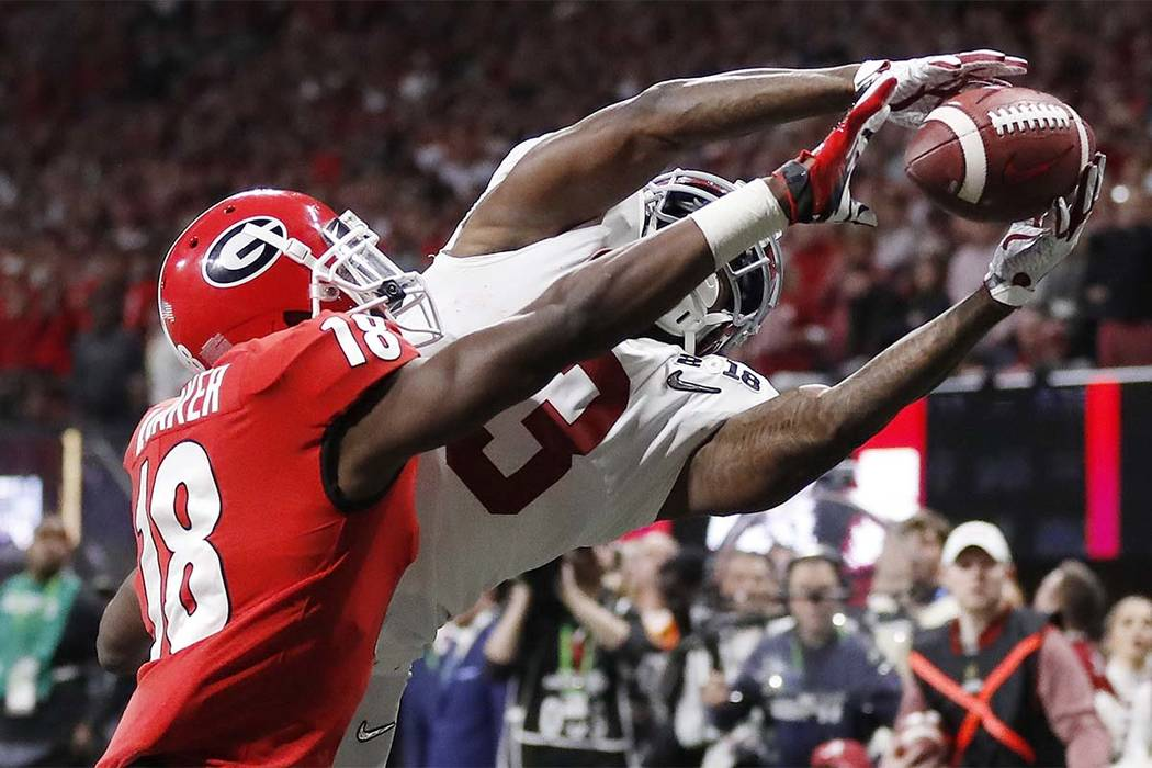 Georgia's Deandre Baker knocks the ball away from Alabama's Calvin Ridley during the second half of Monday's national championship game Monday, Jan. 8, 2018, in Atlanta. (David Goldman/AP)