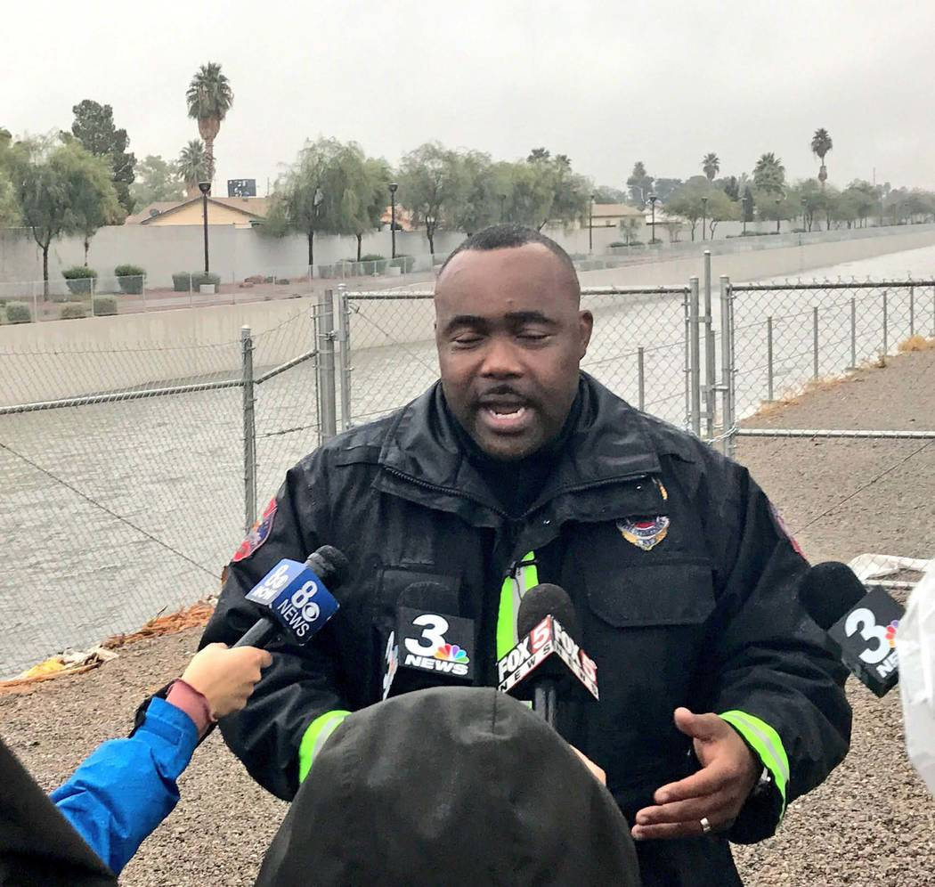 North Las Vegas Capt. Cedric Williams speaks to the media after a swift-water rescue near Carey Avenue and Pecos Road, Tuesday, Jan. 9, 2018. (Rachel Crosby/Las Vegas Review-Journal)