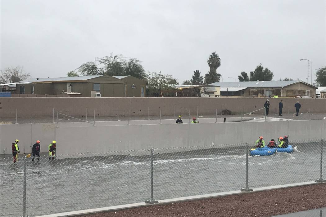 North Las Vegas and Las Vegas fire departments joined forces to rescue two people from a flooded wash near Carey Avenue and Pecos Road, Tuesday, Jan. 9, 2018. (Rachel Crosby/Las Vegas Review-Journal)