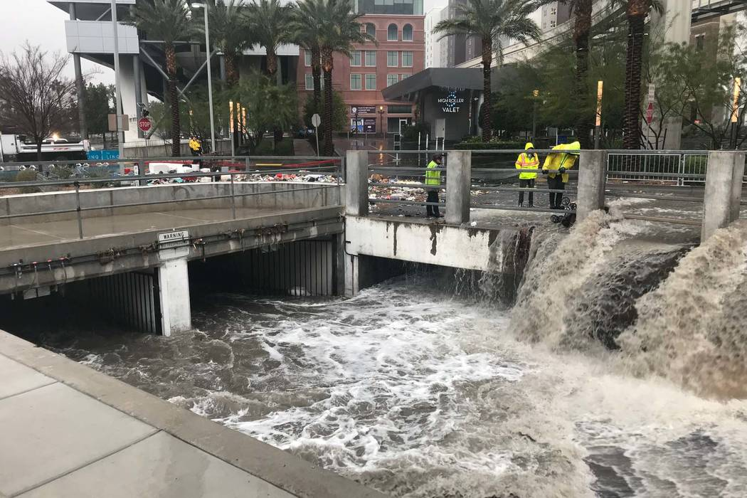 Floodwaters flow out of garage of the Linq on the Las Vegas Strip and run into the wash behind the hotel-casino, Tuesday, Jan. 9, 2018. (Elaine Wilson/Las Vegas Review-Journal)