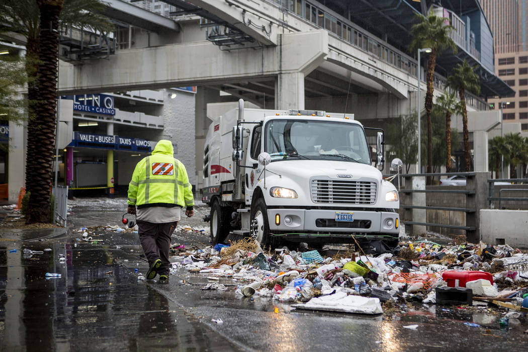 A Clark County Public Works crew cleans up debris swept away by floodwaters near The Linq Hotel in Las Vegas on Tuesday, Jan. 9, 2018. (Patrick Connolly/Las Vegas Review-Journal) @PConnPie