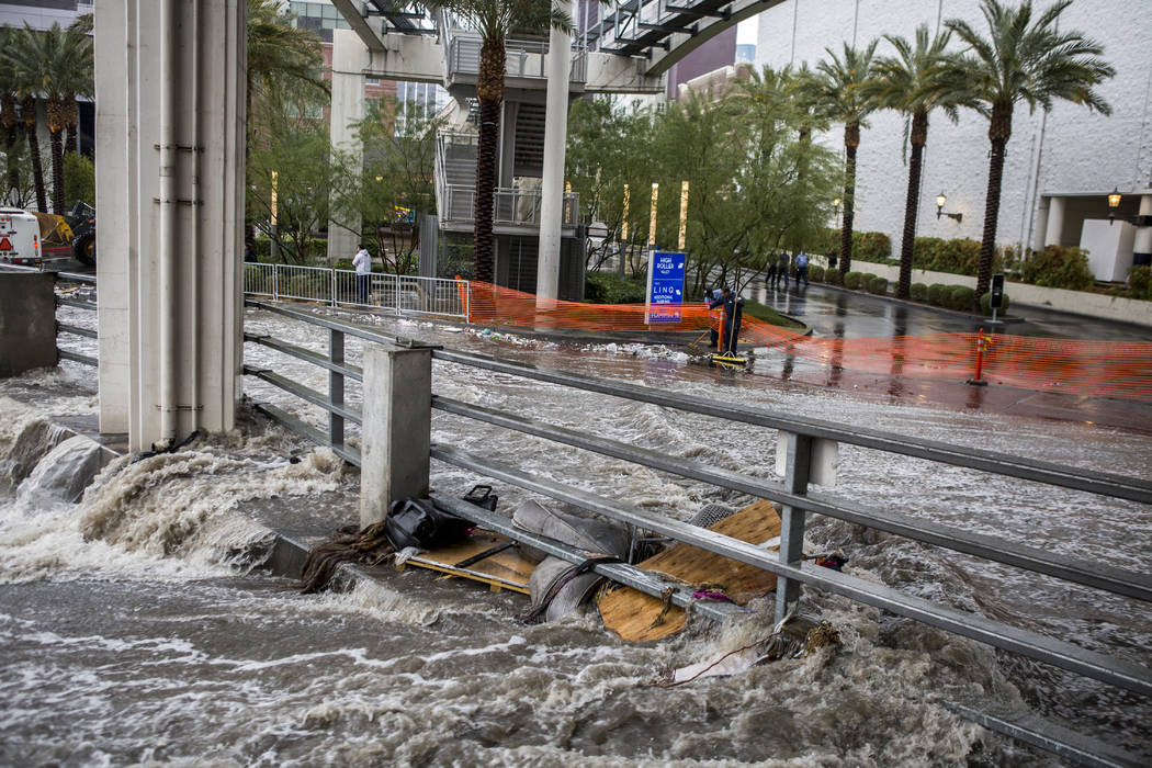 Water rushes into in a flood channel near The Linq Hotel in Las Vegas on Tuesday, Jan. 9, 2018. (Patrick Connolly/Las Vegas Review-Journal) @PConnPie