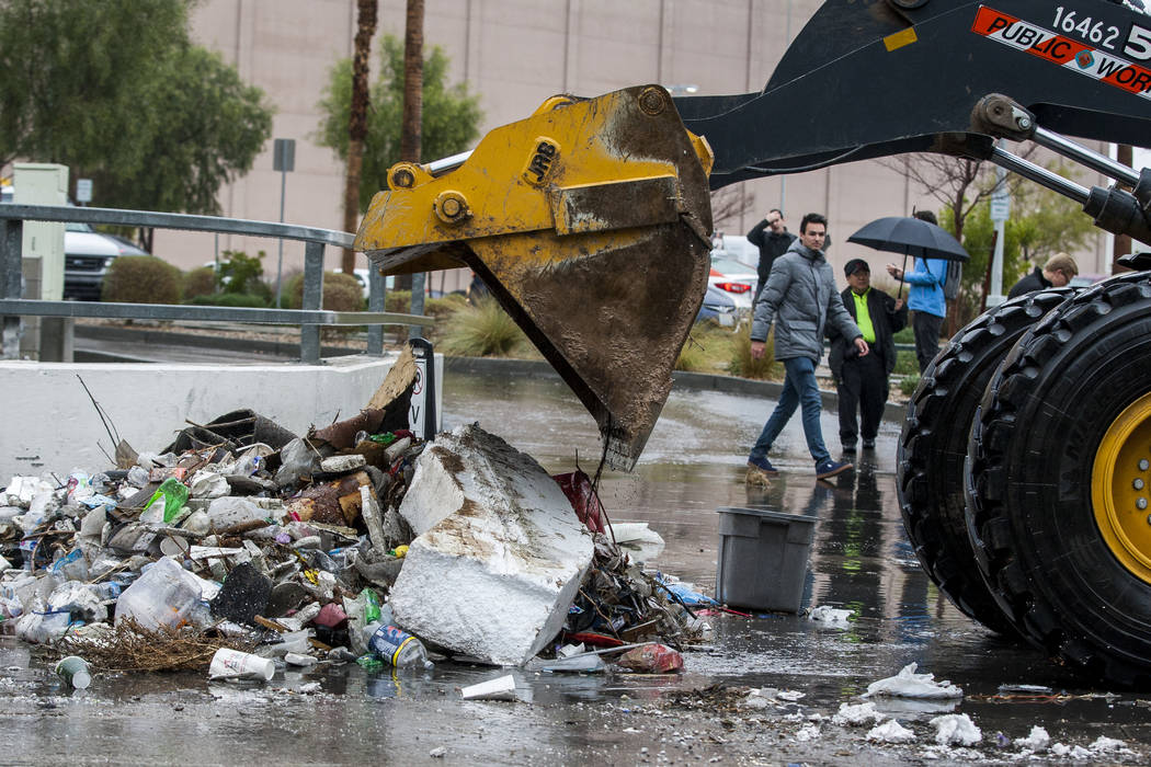 Clark County Public Works crews clears debris resulting from floodwaters near The Linq Hotel in Las Vegas on Tuesday, Jan. 9, 2018. (Patrick Connolly/Las Vegas Review-Journal) @PConnPie