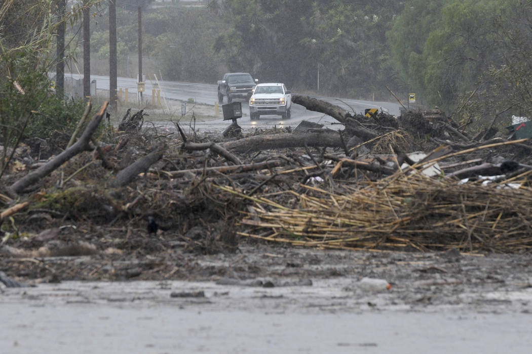 Debris from a swollen creek blocks Via Real in Carpinteria, Calif., Tuesday, Jan. 9, 2018. (AP Photo/Michael Owen Baker)