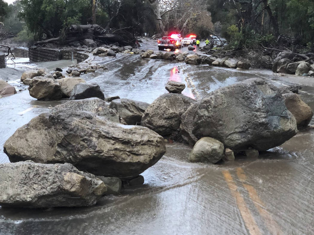 In this photo provided by Santa Barbara County Fire Department,   mud and debris flow on the roadway due to heavy rain in Montecito. Calif., Tuesday, Jan. 9, 2018.   Heavy rains pounding Southern  ...