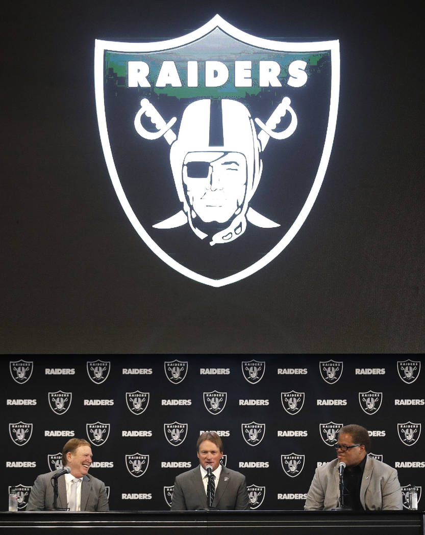 Oakland Raiders head coach Jon Gruden, center, answers questions alongside owner Mark Davis, left, and general manager Reggie McKenzie during an NFL football press conference Tuesday, Jan. 9, 2018 ...