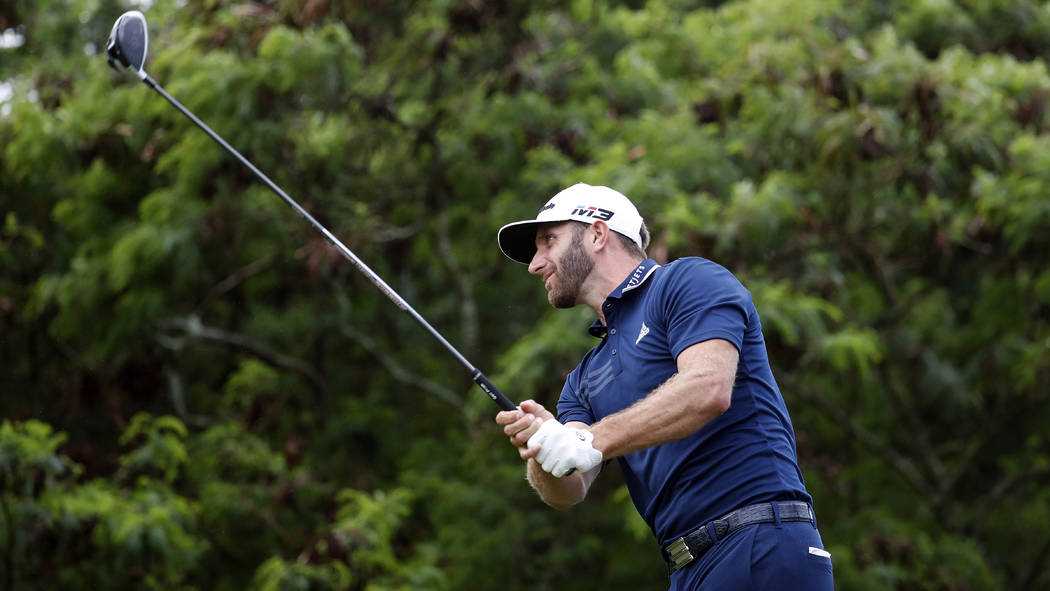 Dustin Johnson plays his shot from the 15th tee during the final round of the Tournament of Champions golf event, Sunday, Jan. 7, 2018, at Kapalua Plantation Course in Kapalua, Hawaii. (AP Photo/M ...